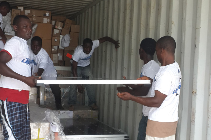 Solar panels being unloaded at Phebe Hospital, Bong County, Liberia