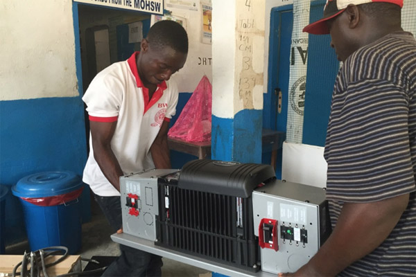 The new inverter being installed at Foequelleh Clinic